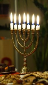 candles burning in menorah